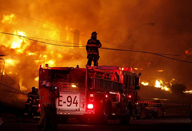 Fire fighters battle a blaze in this photo for offsite Data Backup Disaster Recovery