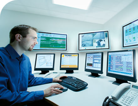 Man Monitoring Computers Remotely